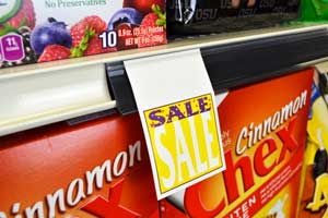 Display tickets and promotions on Lozier and Madix shelving with this clip-in Shelf strip with promo grip